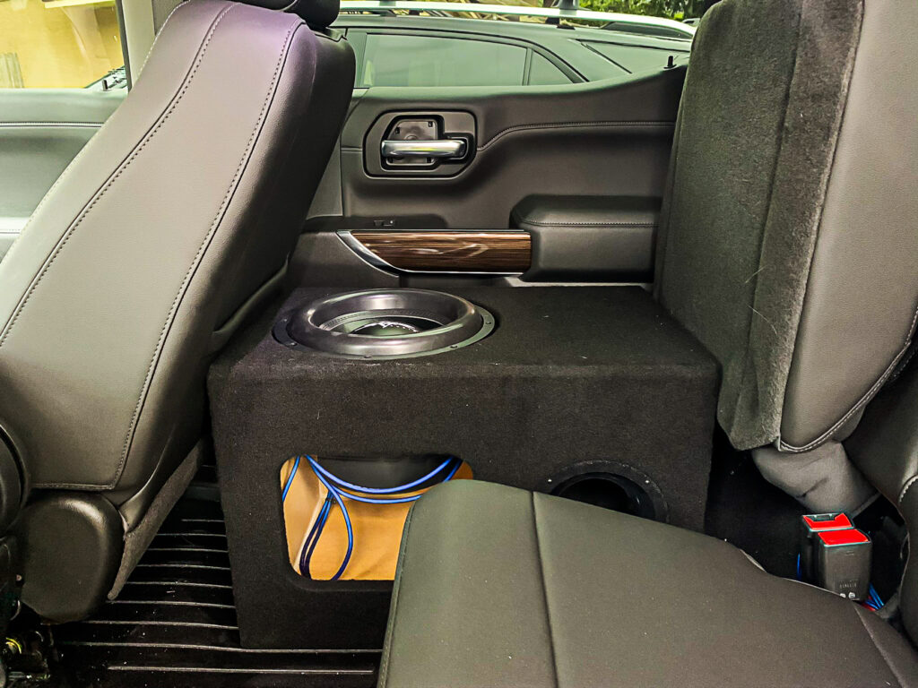 Brett's subwoofer enclosure, complete with battery holder and plexiglass window in his vehicle.